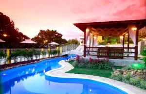 The swimming pool at or near Pousada Villa Real