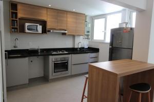A cozinha ou cozinha compacta de Rio Urquiza Beach PA