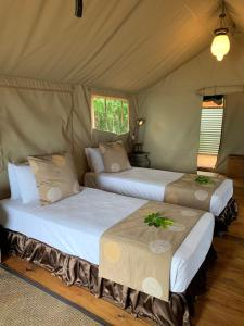A bed or beds in a room at Ratua Island Resort & Spa