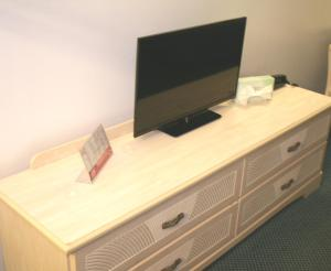 A television and/or entertainment center at Lake Lighthouse Inn