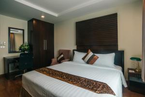 Ein Bett oder Betten in einem Zimmer der Unterkunft iCheck inn Residence soi 2