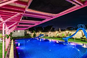 The swimming pool at or close to Gold Airport Suites