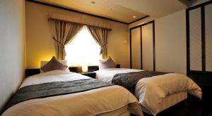 A bed or beds in a room at Hotel Paco Hakodate