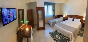 A television and/or entertainment center at Hotel Ristorante Al Boschetto