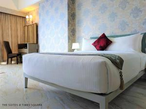 A bed or beds in a room at The Suites @ Times Square