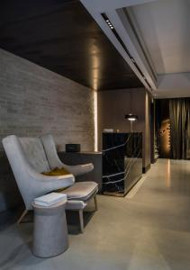 The lobby or reception area at Niki Athens Hotel