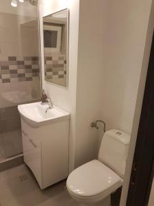 A bathroom at Marcos Apartments