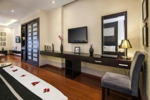 A television and/or entertainment center at Hanoian Central Hotel & Spa