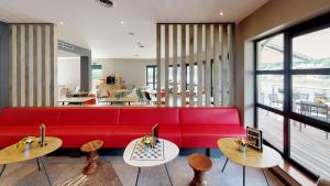 A restaurant or other place to eat at ibis Dinant Centre