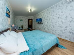 Кровать или кровати в номере Apartment on ulitsa Krasnaya 176 ZK bolshoy