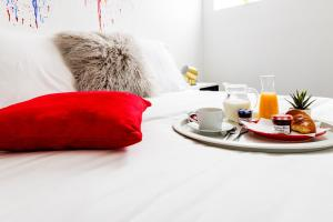 Un ou plusieurs lits dans un hébergement de l'établissement Super Hero Suite - SDP
