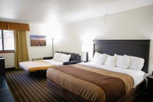 A bed or beds in a room at Billings Hotel & Convention Center
