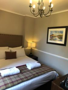 A bed or beds in a room at Stonefield Castle Hotel 'A Bespoke Hotel'
