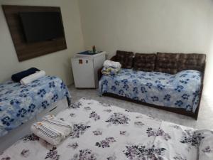 Cama ou camas em um quarto em Pousada do Nei