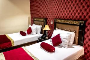 A bed or beds in a room at Rose Palace Hotel, Garden Town