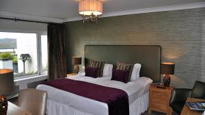 A bed or beds in a room at Beech Hill Hotel & Spa