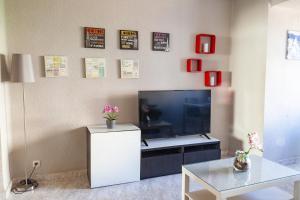 Una televisión o centro de entretenimiento en Apartamento Cardenal