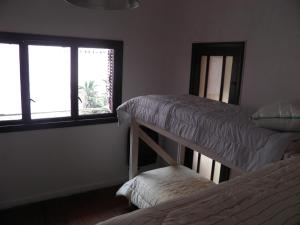 A bunk bed or bunk beds in a room at Rosario Global House