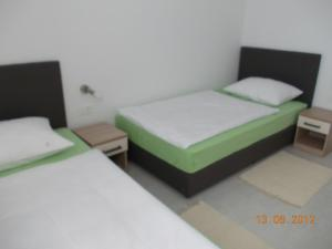 Posteľ alebo postele v izbe v ubytovaní Vila Novak