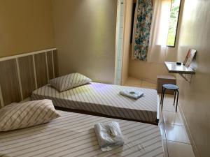 Кровать или кровати в номере HOTEL FLOR DO AMAZONAS (ADULTS ONLY)