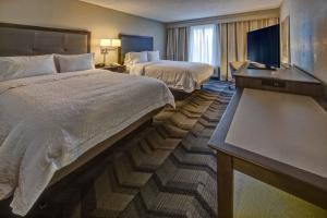 A bed or beds in a room at Hampton Inn & Suites Clermont