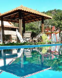 The swimming pool at or near Pousada do Paulinho