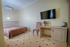 Кровать или кровати в номере Отель Гранд Елец