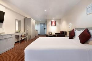 A bed or beds in a room at Furama Silom Hotel