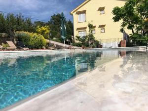 The swimming pool at or near Apartments Lidija