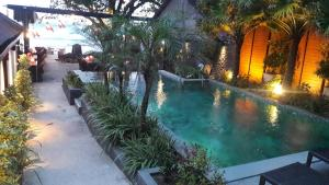 The swimming pool at or near 15 Palms Beach Resort