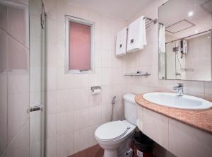 A bathroom at Kc Place Hotel Pratunam