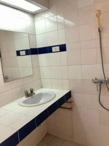 A bathroom at At Bangkok Hotel