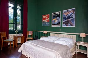 A bed or beds in a room at Boutique Hotel Dobra Vila Bovec