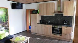 A kitchen or kitchenette at Ferienwohnung Dunja