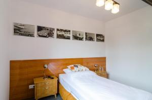 Łóżko lub łóżka w pokoju w obiekcie Stara Piekarnia