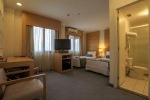 A television and/or entertainment center at Nobile Suites Congonhas