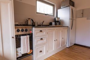 A cozinha ou cozinha compacta de Complejo Odella Casas de Montaña