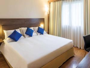 Cama o camas de una habitación en Novotel Manaus