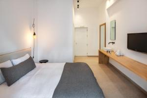 A bed or beds in a room at Hotel Eucalyptus