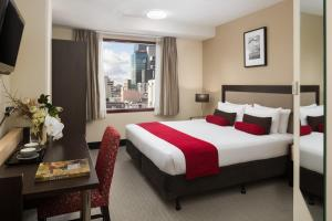A bed or beds in a room at Mercure Welcome Melbourne