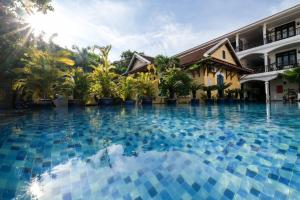 The swimming pool at or close to Le Domaine de Cocodo