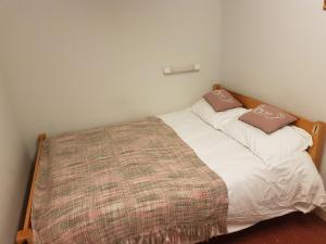 A bed or beds in a room at The Gordon Arms Huntly