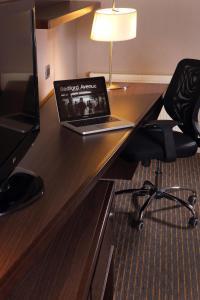 Una televisión o centro de entretenimiento en Holiday Inn Express - Concepcion, an IHG Hotel