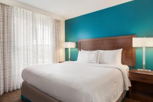 A bed or beds in a room at Residence Inn Las Vegas South
