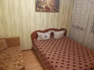 A bed or beds in a room at Apartments for rent
