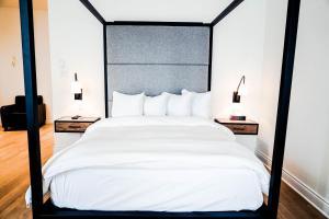Un ou plusieurs lits dans un hébergement de l'établissement Auberge du Carre St-Louis