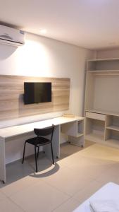 A television and/or entertainment center at Premium Hotel