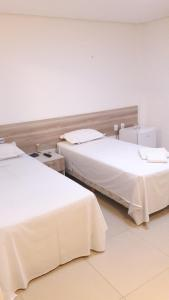 A bed or beds in a room at Premium Hotel