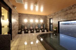 The swimming pool at or near Hotel Route-Inn Toyotajinnaka