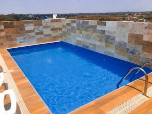 The swimming pool at or close to Apartamento en Country Club Miraflores PIURA
